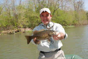 Angler with smallmouth bass on the Shenandoah River, Virginia. Va fishing guides.