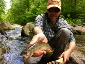 An angler with a nice brook trout