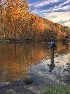 An angler wade fishing on the South Holston river