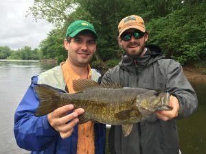 A happy angler and guide with a great smallmouth on the James river near Scottsville Virginia.