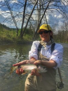 happy angler with a nice rainbow trout.