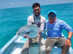 Very happy angler and guide with a Belize and Central America permit caught at La Pescadora Lodge, Ascension Bay, Mexico.