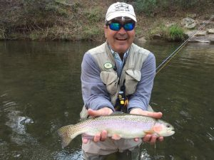 Angler with rainbow trout