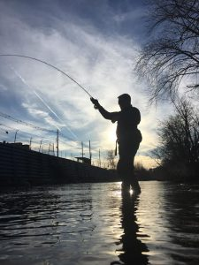 This angler in fighting a trout at sunset during a guide trip in Virginia.