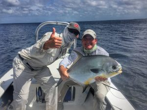 Angler with permit from Belize and Central America. Turneffe Flats, Belize.