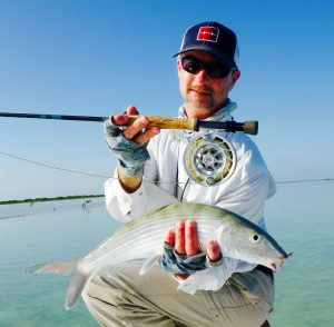 Angler with bonefish in Cuba.