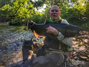 angler with salmon in Pulaski New York.