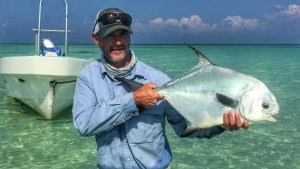 angler with permit cuaght at Belize River Lodge. Belize. Long Caye outpost.