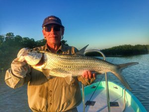 A small tarpon caught while fishing from the Long Caye outpost and Belize River Lodge, Belize.