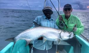 Angler and guide with tarpon caught while fishing Belize River Lodge. November 11, 2017