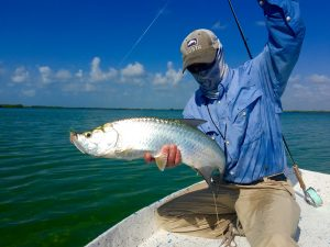 Angler with baby tarpon from Ascension Bay Mexico. Casa Blanca Lodge.