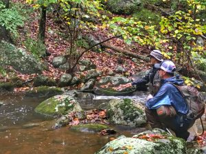 Angler and guide on the Rapidan river, Virginia.