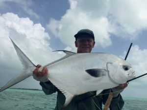 Angler with a permit cuaght at Casa Blanca Lodge.