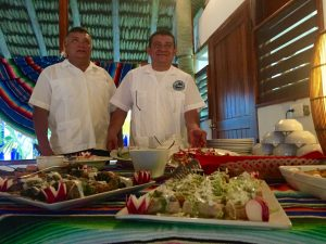 Staff servining food at Casa Blanca Lodge, Ascension bay, Mexico