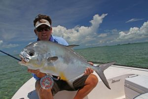 Anlger with permit cuaght on Grand Bahama with H2O bonefishing.