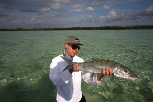 Angler with bonefish in Grand Bahama while fishing with H2O Bonefishing.