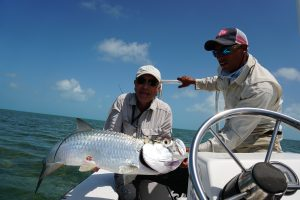 Angler Larry L, holding a tarpon caught while fishing in Cuba from Avalon 1 in Isle of Youth, Cuba.