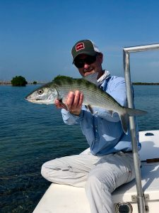 Angler with a bonefish caught in Cuba while fishing from Avalon 1 mother ship in Isle of Youth, Cuba. Isla de la Juventud.