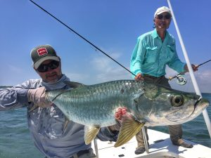 Angler with tarpon in Isle of Youth, Cuba. Avalon fishing charters.