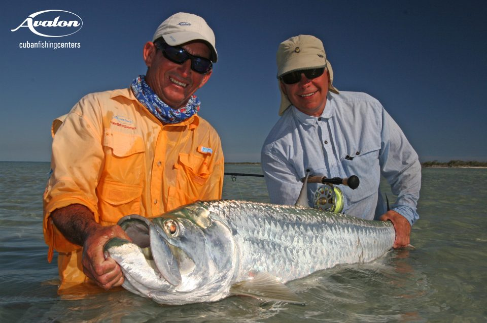 Cuba/Avalon. Angler and guide holding a tarpon caught while fishing in Cuba.