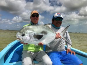 Very happy angler with a beautiful permit caught in Ascension Bay Mexico.