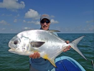 Dr. Peter Netland with a beautiful permit caught in Ascension Bay Mexico.