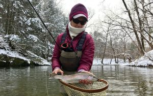 A beautiful rainbow trout caught while winter fishing in Virginia with an Charlottesville Va, fishing guide.