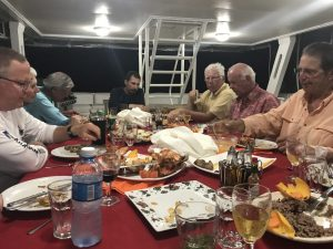 A group of anglers on Avalon 1 mother ship having dinner in Cuba. Fly fish Cuba.