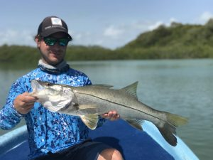 a happy angler with a nice snook caught while fishing with La Pescadora Lodge.