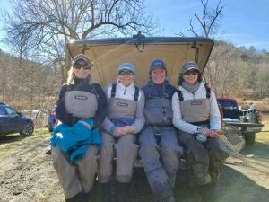 Four female fly fishers taking a break from the ladies fly fishing class on Big Bend Farm. Learing how tho fly fish with Virginia fishing guides.