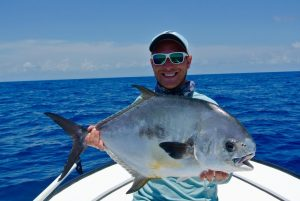 angler with permit caught at turneffe flats, Belize.