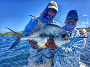 Angler and guide with permit caught at Turneffe Flats, Belize and Central America.