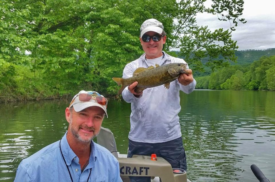 Angler and guide with smallmouth bass on the Shenandoah river