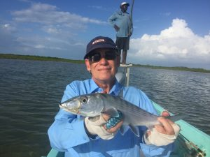 Angler with bonefish cuaght at Belize River Lodge, Belize.