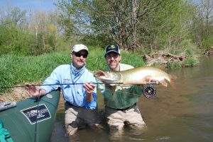 Angler and guide standing the water with a nice Shenandoah River Musky.