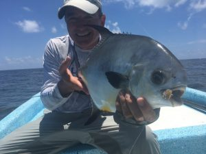 An angler with a permit caught in Ascension Bay Mexico. Virginia fly fishing guides leading trips to central america.